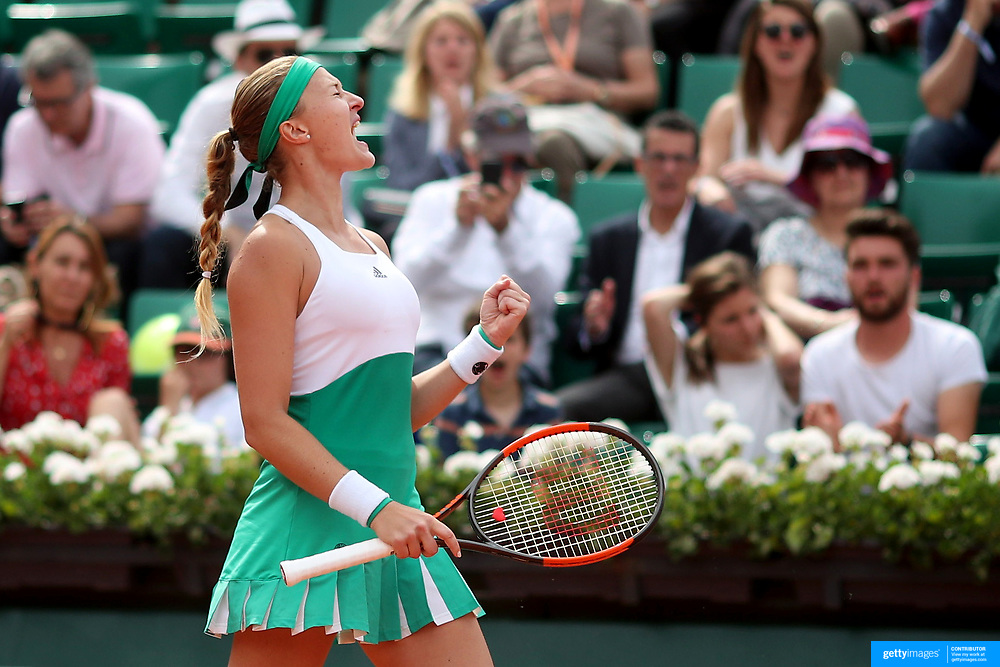 2017 French Open Tennis Tournament - Day Eight.  Kristina Mladenovic of France celebrates a service break against Garbine Muguruza of Spain in the Women's Singles round four match in front of a full house on Suzanne-Lenglen Court at the 2017 French Open Tennis Tournament at Roland Garros on June 4th, 2017 in Paris, France.  (Photo by Tim Clayton/Corbis via Getty Images)