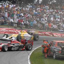 8 August, 2010; Dreyer & Reinbold Racing's JUSTIN WILSON's damaged car rolls to a staop after a crash with E.J. Viso during the Izod IndyCar Series Honda Indy 200 at the Mid-Ohio Sports Car Course in Lexington, Ohio..Mandatory Credit: Will Schneekloth / Southcreek Global
