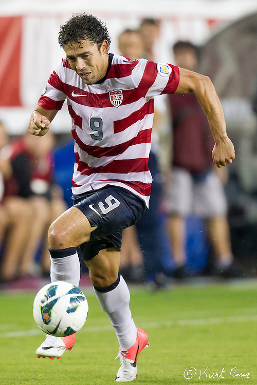 USA Men's National Team forward HERCULEZ GOMEZ (9) during the Antigua & Barbuda vs USA Men's National Team  semifinal round of 2014 FIFA World Cup qualifier at Raymond James Stadium in Tampa, Fl. .