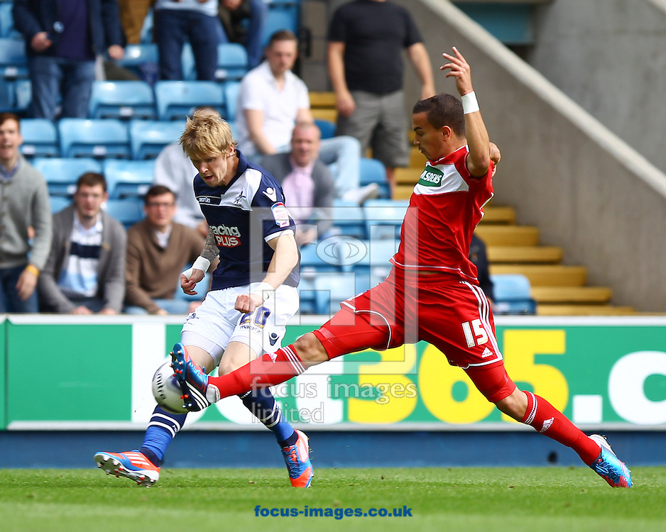Picture by John  Rainford/Focus Images Ltd +44 7506 538356.01/09/2012.Andy Keogh of Millwall and Seb Hines of Middlesbrough during the npower Championship match at The Den, London.