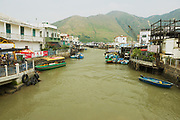 HONG KONG, CHINA - SEPTEMBER 15, 2012: View to the Tai O fishermen village with stilt houses and motorboats in Hong Kong, China. Tai O is a famous tourist destination in Hong Kong.
