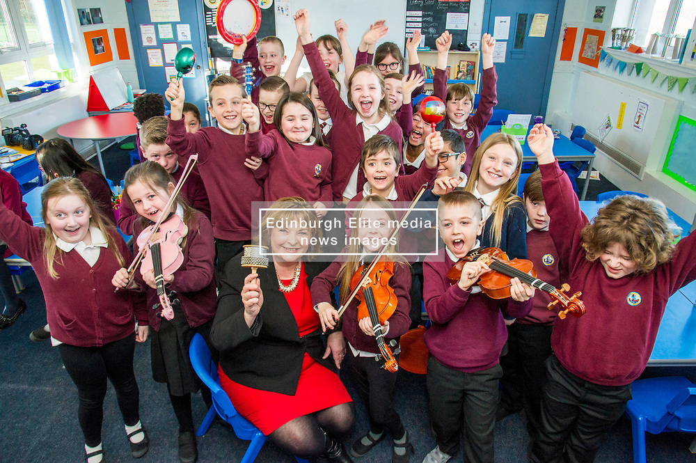Pictured: Fiona Hyslop joined the primary four pupils as they practiced their musical skills<br /> <br /> Culture Secretary Fiona Hyslop MSP unveiled cash awards for Youth Music Initiative schemes which will help young people learn about and enjoy music. Ms Hyslop made the announcement when she joined schoolchildren at Longstone Primary School, Edinburgh today.<br /> <br /> <br /> Ger Harley | EEm 8 March 2018