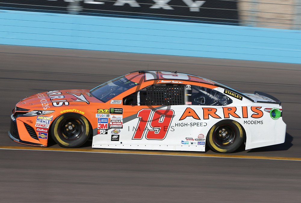 Daniel Suarez qualifies for Sunday's NASCAR Cup Series auto race on Friday, March 17, 2017, in Avondale, Ariz.  (AP Photo/Rick Scuteri)