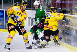 Yves Sarault of Vienna, Egon Muric of Olimpija and Philippe Lakos of Vienna during 52nd Round of EBEL league ice-hockey match between HDD Tilia Olimpija, Ljubljana and EV Vienna Capitals, on February 7, 2010 in Arena Tivoli, Ljubljana, Slovenia. Vienna defeated Olimpija 8-2. (Photo by Vid Ponikvar / Sportida)