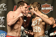 LAS VEGAS, NEVADA, JULY 10, 2009: CB Dolloway (left) and Tom Lawlor face off during the weigh-in for UFC 100 inside the Mandalay Bay Events Center in Las Vegas, Nevada