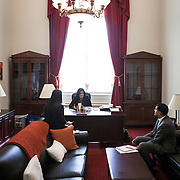 Representative Pramila Jayapal (D-WA, 7) eats lunch at her desk, while meeting with her Deputy chief of Staff, Ven Neralla, right, and Legislative Assistant, Jennifer Chan, on Tuesday, January 31, 2017.  John Boal photo/for The Stranger