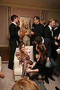 EDDIE REDMAYNE, DONATELLA VERSACE AND MARIO TESTINO ABOVE ALICE DELLAL AND CHARLOTTE CASIRAGHI, Dinner hosted by Elizabeth Saltzman for Donatella Versace. Claridge's Hotel, Brook Street, Mayfair, London. 11 March 2008.  *** Local Caption *** -DO NOT ARCHIVE-© Copyright Photograph by Dafydd Jones. 248 Clapham Rd. London SW9 0PZ. Tel 0207 820 0771. www.dafjones.com.