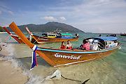 """The tiny Thai island of Koh Lipe in the Andaman Sea is home to a group of so called """"Sea Gypsies"""" or Chao Leh people. While they traditionally made a living from fishing, dwindling fish stocks and a growing number of foreign visitors force them to try their luck in the tourism business - for instance by renting their long tail boats for snorkel trips."""
