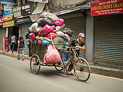 06 AUGUST 2015 - KATHMANDU, NEPAL:  A man collects garbage on his bicycle in Kathmandu, Nepal. He will sort through the garbage and sell that which is recyclable.    PHOTO BY JACK KURTZ
