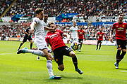 Frederico Fernandez of Swansea City is challenged by Daley Blind of Manchester United during the Premier League match between Swansea City and Manchester United at the Liberty Stadium, Swansea, Wales on 19 August 2017. Photo by Andrew Lewis.