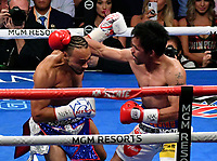 LAS VEGAS, NEVADA - JULY 20. <br /> Manny Pacquiao (R) hits Keith Thurman during their fight for the WBA welterweight title fight at MGM Grand Garden Arena on July 20, 2019 in Las Vegas, Nevada. Pacquiao went 12 rounds and took the win by a split decision.  (MB Media)