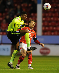 Rohan Ince of Brighton & Hove Albion challenges for the ball with Tom Bradshaw of Walsall - Mandatory byline: Dougie Allward/JMP - 07966386802 - 25/08/2015 - FOOTBALL - Bescot Stadium -Walsall,England - Walsall v Brighton - Capital One Cup - Second Round