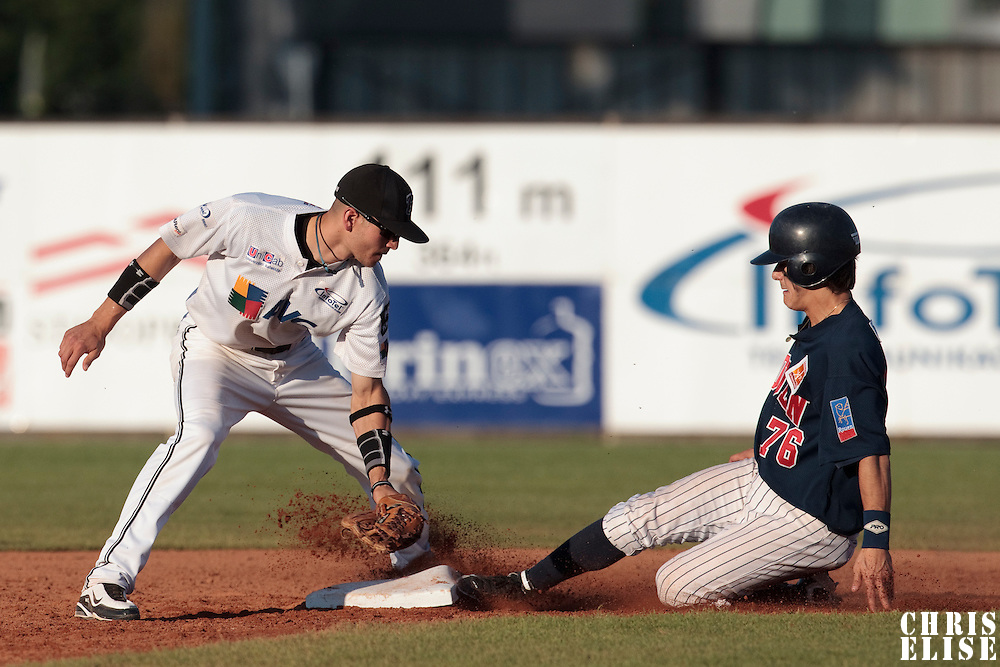 06 June 2010: Maxime Lefevre of Rouen slides safely into second base against second base Martin Schneider of AVG Draci Brno during the 2010 Baseball European Cup match won 10-8 by the Rouen Huskies over AVG Draci Brno, at the AVG Arena, in Brno, Czech Republic.