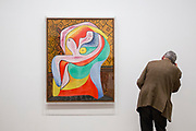 """UNITED KINGDOM, London: 06 March 2018 A visitor takes a close look at Picasso's """"Rest"""" (1932) at The Tate Modern's new exhibition 'Picasso 1932: Love, Fame, Tragedy'. The exhibition, which consists of a wide range of Picasso works, runs from 8th March - 9 September 2018.  Rick Findler / Story Picture Agency"""