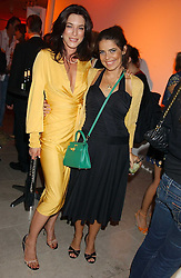 Left to right, Actress JAIME MURRAY and DANIELLA HELAYEL at a cocktail party hosted by MAC cosmetics to kick off London Fashion Week at The Hospital, 22 Endell Street London on 18th September 2005.At the event, top model Linda Evangelista presented Ken Livingston the Lord Mayor of London with a cheque for £100,000 in aid of the Loomba Trust that aims to privide education to orphaned children through a natural disaster or through HIV/AIDS.<br />