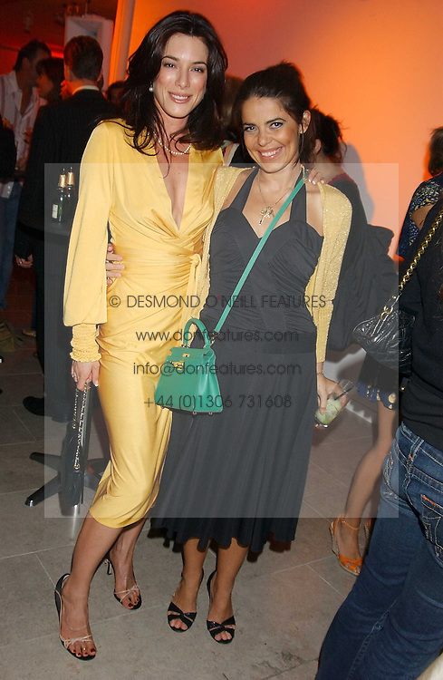 Left to right, Actress JAIME MURRAY and DANIELLA HELAYEL at a cocktail party hosted by MAC cosmetics to kick off London Fashion Week at The Hospital, 22 Endell Street London on 18th September 2005.At the event, top model Linda Evangelista presented Ken Livingston the Lord Mayor of London with a cheque for £100,000 in aid of the Loomba Trust that aims to privide education to orphaned children through a natural disaster or through HIV/AIDS.<br /><br />NON EXCLUSIVE - WORLD RIGHTS