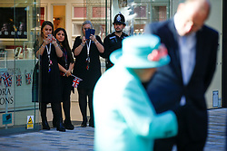 Staff photograph Queen Elizabeth II during a visit to the Lexicon shopping centre in Bracknell.