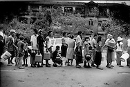 Residents of Chinatown line up for distribution of clean water, Yangon, Burma (Myanmar).