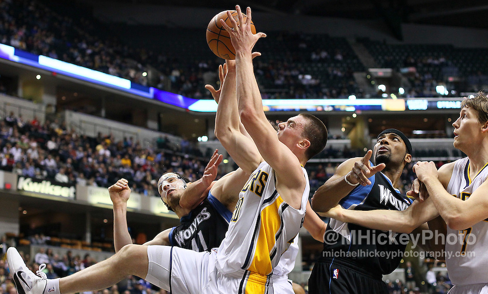 Feb. 11, 2011; Indianapolis, IN, USA; Indiana Pacers forward Tyler Hansbrough (50) fights for a rebound with Minnesota Timberwolves center Kosta Koufos (41) at Conseco Fieldhouse. Mandatory credit: Michael Hickey-US PRESSWIRE