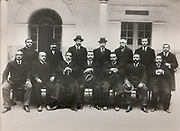 Photograph of Antonio Machado (third from the right, first row), 1875-1939, Spanish poet and professor, with colleagues, in the Palacio de Jabalquinto, now the Universidad Internacional de Andalusia (UNIA), or International University of Andalusia, in Baeza, Jaen, Andalusia, Spain. The palace is listed as a historic monument and the Renaissance buildings of Ubeda and Baeza are listed as a UNESCO World Heritage Site. Picture by Manuel Cohen