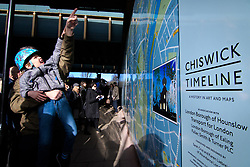 &copy; Licensed to London News Pictures. <br /> 28/1/2018. London, Great Britain.  <br /> Members of the public during the opening of The Chiswick Timeline, a history in art and Maps<br /> 16 large historic maps and 23 works of art by leading artists showing Chiswick landmarks.<br /> The Chiswick Timeline celebrates the history of a part of London that was once a village west of the capital on the banks of the River Thames.<br /> The landmark work of art is situated under the railway bridges under Turnham Green tube station.<br /> <br /> Photo credit: Anthony Upton/LNP