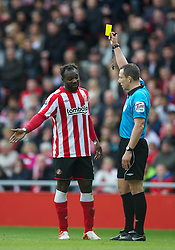 SUNDERLAND, ENGLAND - Sunday, March 20, 2011: Sunderland's John Mensah is shown a yellow card by referee Kevin Friend during the Premiership match against Sunderland at the Stadium of Light. (Photo by David Rawcliffe/Propaganda)
