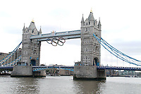 LONDON - JUNE 27: Giant Olympic rings were lowered today on Tower Bridge to mark the countdown to the London 2012 Olympic Games. Tower Bridge, London, UK. June 27, 2012. (Photo by piQtured)
