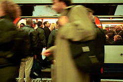 UK ENGLAND LONDON 13MAR02 - City workers leave the City by underground during rush hour - overcrowded Central Line train at Bank Station. ..The London Underground is a rapid transit system serving a large part of Greater London and neighbouring areas of Essex, Hertfordshire and Buckinghamshire in the UK. The Underground has 270 stations and about 400 km of track, making it the longest metro system in the world by route length; it also has one of the highest number of stations and transports over three million passengers daily...jre/Photo by Jiri Rezac..© Jiri Rezac 2002