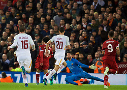 LIVERPOOL, ENGLAND - Tuesday, April 24, 2018: Liverpool's Mohamed Salah scores the second goal past AS Roma's goalkeeper Alisson Becker during the UEFA Champions League Semi-Final 1st Leg match between Liverpool FC and AS Roma at Anfield. (Pic by David Rawcliffe/Propaganda)