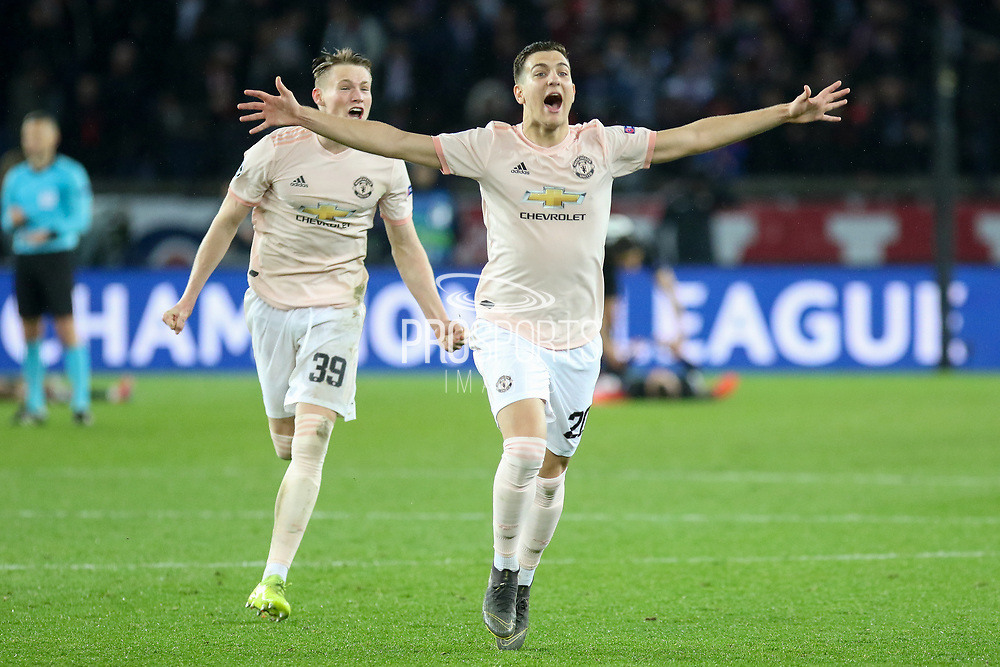 Manchester United Defender Diogo Dalot and Manchester United Midfielder Scott McTominay celebrate after whistle during the Champions League Round of 16 2nd leg match between Paris Saint-Germain and Manchester United at Parc des Princes, Paris, France on 6 March 2019.