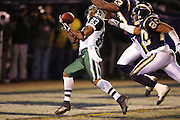 SAN DIEGO, CA - JANUARY 8:  Wide receiver Santana Moss of the New York Jets catches a 47 yard touchdown pass in the 3rd quarter for a 14-7 Jets lead while defended by safety Jerry Wilson #20 and cornerback Quentin Jammer #23 of the San Diego Chargers at Qualcomm Stadium on January 8, 2005 in San Diego, California. The Jets defeated the Chargers 20-17 in overtime in the AFC Wild Card Game. ©Paul Anthony Spinelli  *** Local Caption *** Santana Moss; Jerry Wilson; Quentin Jammer