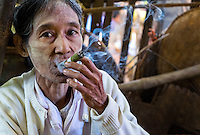 BAGAN, MYANMAR - CIRCA DECEMBE 2013: Old Burmese woman smoking a cigar in the Nyaung U market close to Bagan in Myanmar