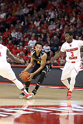 14 February 2015:   Cory Henderson Jr. cuts between Bobby Hunter and Daishon Knight during an NCAA MVC (Missouri Valley Conference) men's basketball game between the Wichita State Shockers and the Illinois State Redbirds at Redbird Arena in Normal Illinois
