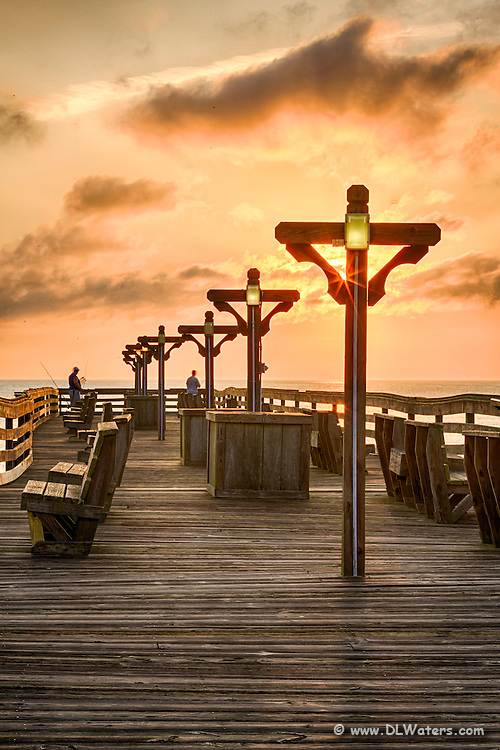 Sunrise on Kitty Hawk Fishing Pier on the Outer banks.