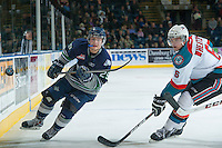 KELOWNA, CANADA -FEBRUARY 10: Roberts Lipsbergs #29 of the Seattle Thunderbirds passes the puck as Mitchell Wheaton #6 of the Kelowna Rockets comes in for the check during second period on February 10, 2014 at Prospera Place in Kelowna, British Columbia, Canada.   (Photo by Marissa Baecker/Getty Images)  *** Local Caption *** Mitchell Wheaton; Roberts Lipsbergs;
