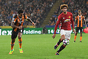 Manchester United player Marouane Fellaini (27) and Hull City midfielder Tom Huddlestone (8)  during the Premier League match between Hull City and Manchester United at the KCOM Stadium, Kingston upon Hull, England on 27 August 2016. Photo by Ian Lyall.