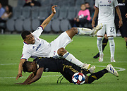 FC Dallas midfielder Jacori Hayes (15) is tripped up by LAFC forward Latif Blessing (7) during a MLS soccer match in Los Angeles, Thursday, May 16, 2019. LAFC defeated FC Dallas 2-0.  (Ed Ruvalcaba/Image of Sport)