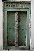 Africa. Tanzania. Zanzibar. Stone town..Green carved door..CD0011