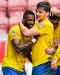Darren Bent of Derby County celebrates with Chris Martin after scoring his sides second goal to make the score 0-2   - Photo mandatory by-line: Matt McNulty/JMP - Mobile: 07966 386802 - 06/04/2015 - SPORT - Football - Wigan - DW Stadium - Wigan Athletic v Derby County - SkyBet Championship