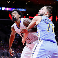 02 October 2015: Los Angeles Clippers center DeAndre Jordan (6) vies for the rebound with Denver Nuggets forward Joffrey Lauvergne (77) during the Los Angeles Clippers 103-96 victory over the Denver Nuggets, in a preseason game, at the Staples Center, Los Angeles, California, USA.