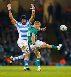 Ireland Fly-Half Ian Madigan clears past Argentina Lock Tomas Lavanini - Mandatory byline: Rogan Thomson/JMP - 07966 386802 - 18/10/2015 - RUGBY UNION - Millennium Stadium - Cardiff, Wales - Ireland v Argentina - Rugby World Cup 2015 Quarter Finals.