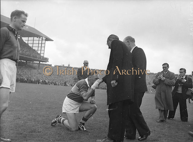 Kerry Captain, P. Sheehy kisses ring of Rev. Dr. Morris Archbishop of Cashel before the All Ireland Senior Gaelic Football Final Kerry v Down in Croke Park on the 22nd September 1960. Down 2-10 Kerry 0-8.