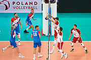 Poland, Warsaw - 2017 August 24: Bartlomiej Lemanski from Poland blocks the ball during LOTTO EUROVOLLEY POLAND 2017 - European Championships in volleyball  at Stadion PGE Narodowy on August 24, 2017 in Warsaw, Poland.<br /> <br /> Mandatory credit:<br /> Photo by &copy; Adam Nurkiewicz<br /> <br /> Adam Nurkiewicz declares that he has no rights to the image of people at the photographs of his authorship.<br /> <br /> Picture also available in RAW (NEF) or TIFF format on special request.<br /> <br /> Any editorial, commercial or promotional use requires written permission from the author of image.