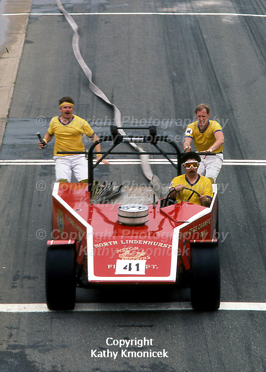 The North Lindenhurst Fire Department Piston Knockers Racing Team in action in July of 1982.