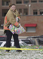 Mallory Creech, from Lewisburg puts out eggs prior to an Easter egg hunt sponsored by the Montgomery County Sheriff's Office Police Athletic League, Saturday morning.  Mallory is part of the Harrison Township Fire Department, who helped put out all the eggs.  The yellow tape is the separation of age groups..