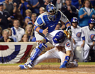 CHICAGO, IL - OCTOBER 15:  Javier Baez #9 of the Chicago Cubs steals home in the second inning, sliding under the tag of Carlos Ruiz #51 of the Los Angeles Dodgers during Game 1 of NLCS at Wrigley Field on Saturday, October 15, 2016 in Chicago, Illinois. (Photo by Ron Vesely/MLB Photos via Getty Images)