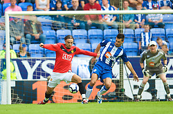 WIGAN, ENGLAND - Saturday, August 22, 2009: Manchester United's Dimitar Berbatov and Wigan Athletic's Paul Scharner during the Premiership match at the DW Stadium. (Photo by David Rawcliffe/Propaganda)