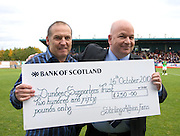 Paul Goodwin of Stirling Albion presents Stuart Murphy, Dundee FC Supporters' Society representative on the Dens board with a donation to help the Dark Blues' bid for survival - Stirling Albion v Dundee, IRN BRU Scottish League 1st Division, Forthbank Stadium, Stirling<br /> <br />  - © David Young<br /> ---<br /> email: david@davidyoungphoto.co.uk<br /> http://www.davidyoungphoto.co.uk