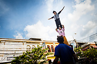 The Phare Circus puts on a quick public show in downtown Siem Reap to drum up excitement for the evening's performance.