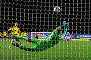 Alex Bass (35) of Portsmouth makes a save from Josh Ruffels (3) of Oxford United during the penalty shootout during the Leasing.com EFL Trophy match between Oxford United and Portsmouth at the Kassam Stadium, Oxford, England on 8 October 2019.